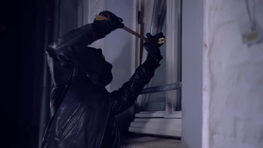 masked burglars breaking and entering into a victim's home #23767951