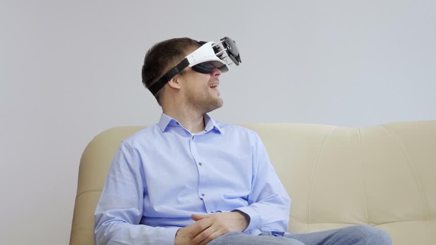 Man in a virtual reality mask observing digital video game world. VR. Studio shot. | Shutterstock HD Video #23775172