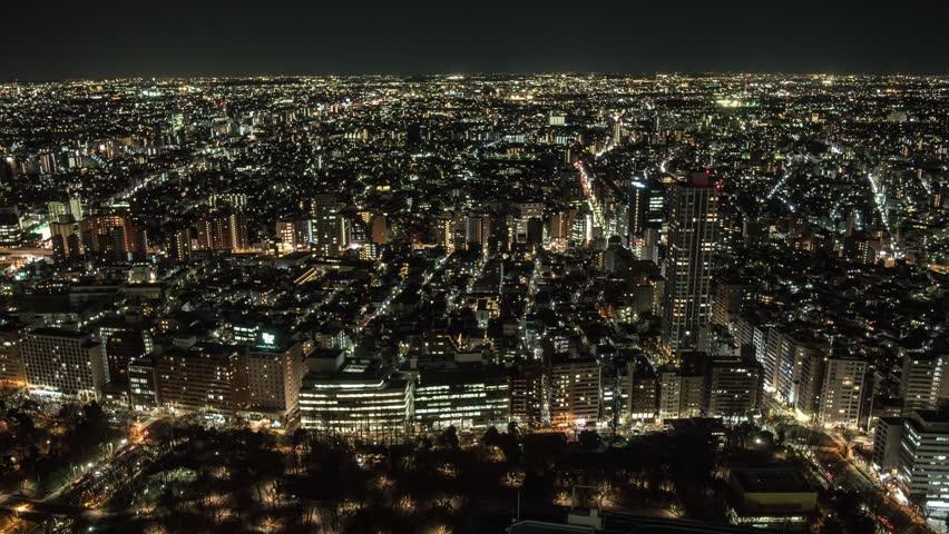 Panning timelapse footage of Shinjuku business district skyline at night, Tokyo, Japan | Shutterstock HD Video #23776513