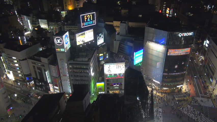 TOKYO - 10 APRIL 2012, Aerial view of busy town with neon sign advertising on skyscraper by night | Shutterstock HD Video #23777380