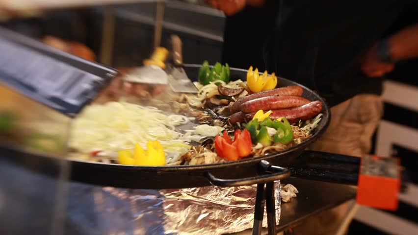 Barbecue sausage with vegetables big grill outdoors in Montmartre area festival, Paris | Shutterstock HD Video #23778955