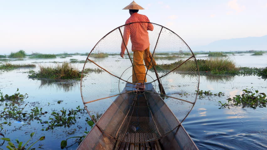 Inle Lake fisherman rowing boat in traditional style at sunrise, Shan State, Myanmar (Burma). | Shutterstock HD Video #23786740