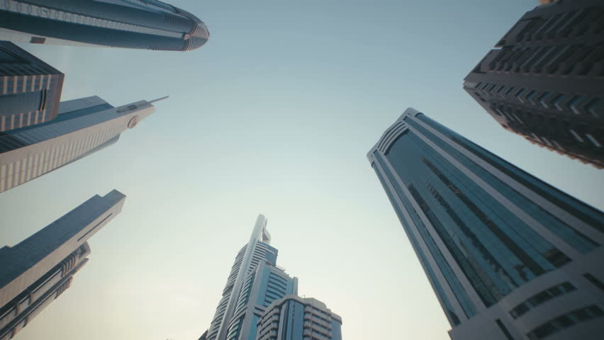 Skyscrapers with stained-glass facades in the UAE. Stone jungle: modern architecture and high buildings in Dubai. Busy vehicular traffic. The modern and developed metropolis. Urban.