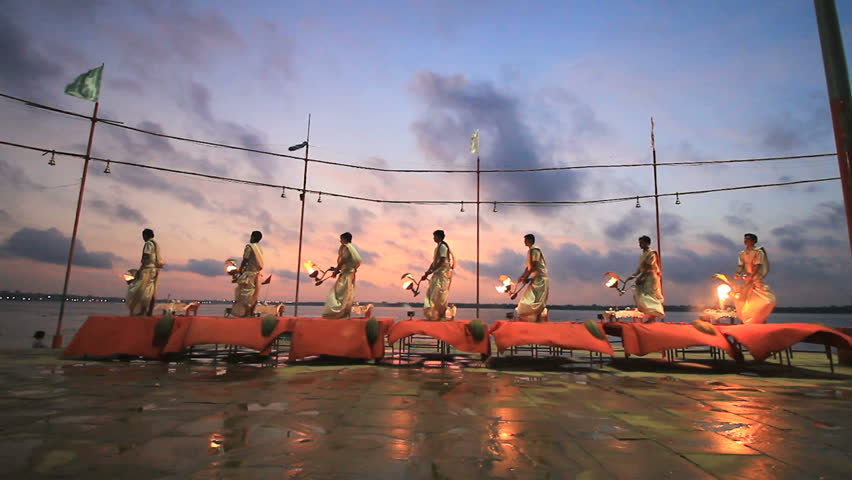 VARANASI INDIA 8 AUG 2016 : Costumed Hindu performs traditional prayer with fire the Ganga Aarti ritual in Varanasi. Fire puja ritual takes place at Dashashwamedh Ghat on the banks of the river Ganges