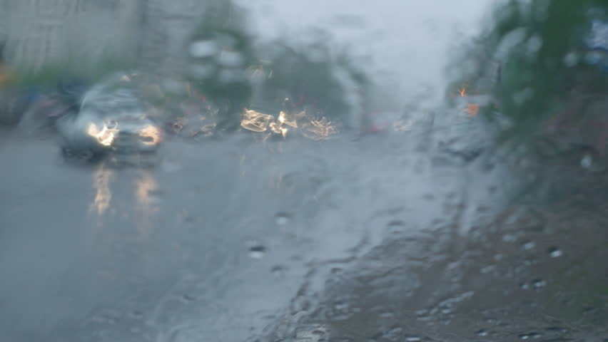 Rain on car front window.Driving in rain | Shutterstock HD Video #2381153