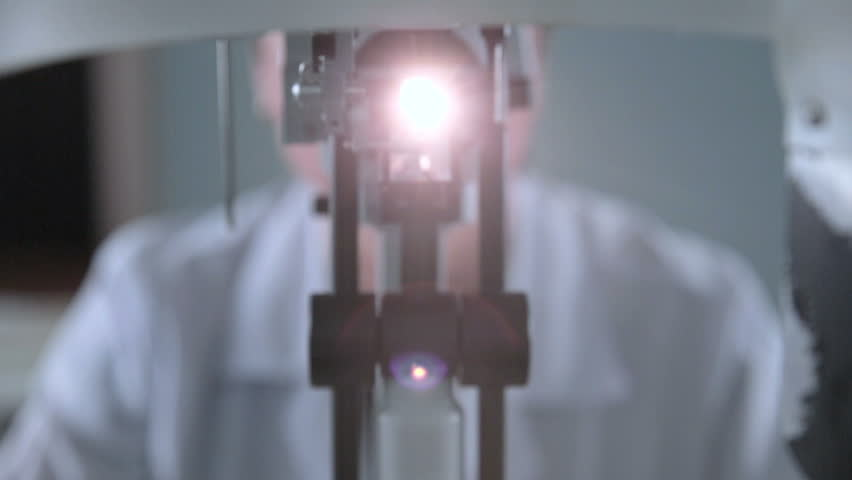 A medical ophthalmological device for checking of eyesight. Unrecognizable doctor working with patient eye testing. | Shutterstock HD Video #23812012