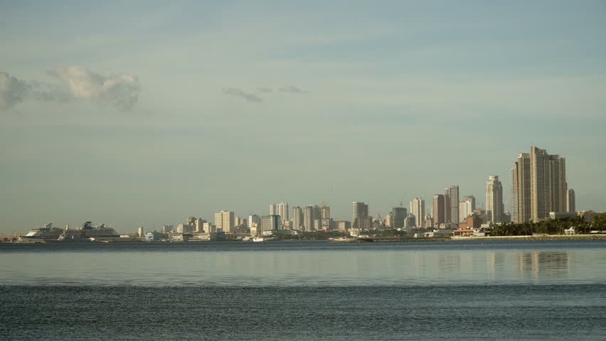 Manila city, skyscrapers and buildings. Seascape coastal city of Manila. Modern city by sea. Makati district. 4K video. Travel concept. | Shutterstock HD Video #23822239