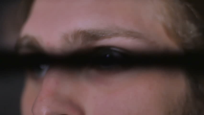 Close-up: a bright light blinks on the man's eyes on a concert | Shutterstock HD Video #23835655