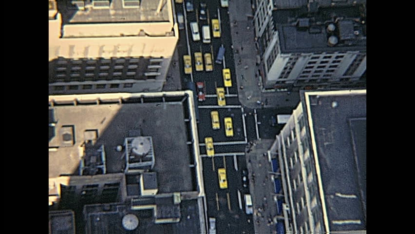 New York, United States of America - circa 1970: vintage panorama on seventy from Empire State Building top, aerial view of typical yellow taxis in the Manhattan traffic.