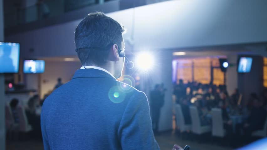 Caucasian speaker teaching at international conference, panning shot | Shutterstock HD Video #23853724