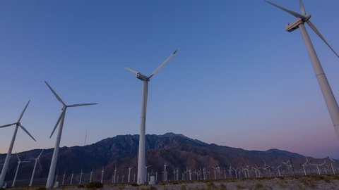 Timelapse with zoom out motion of sunrise at Palm Spring Wind Farm in California