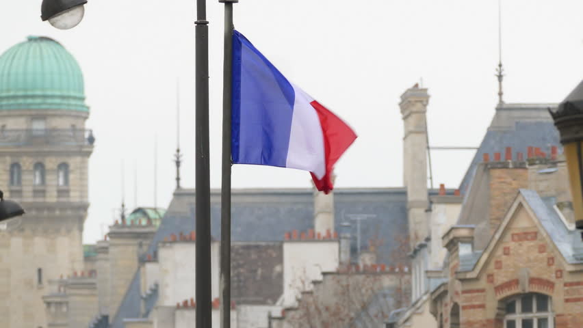 French flag waving in breeze with city of Paris, France in background  | Shutterstock HD Video #23873569