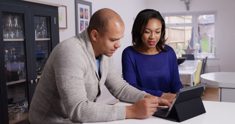 4K Happy attractive couple shopping online at home, excited about their purchases Royalty-Free Stock Footage #23875540