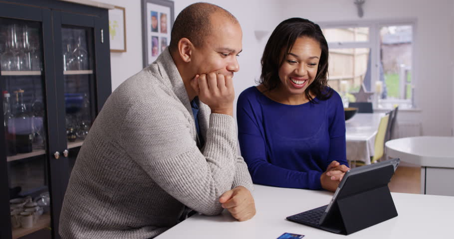 4K Happy attractive couple shopping online at home, excited about their purchases Royalty-Free Stock Footage #23875552