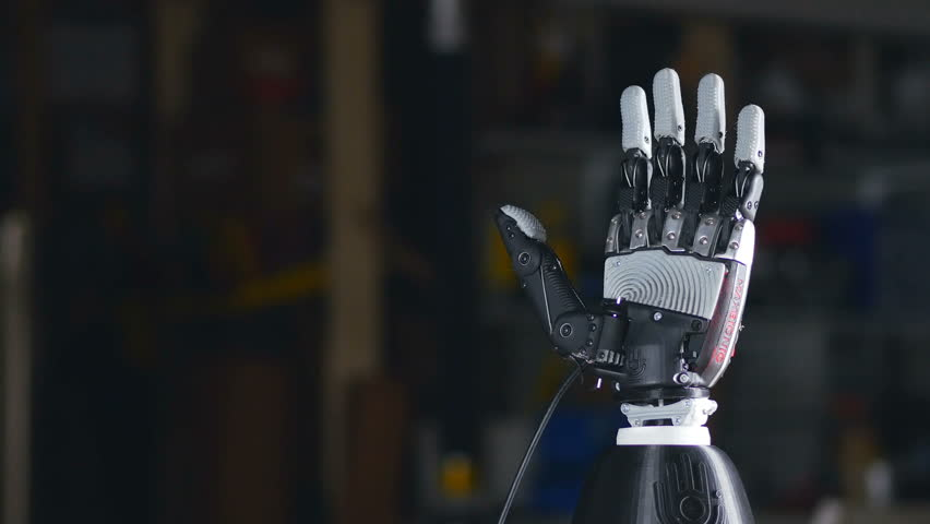 Bionic arm. Innovative robotic hand made on 3D printer. Futuristic technology. Timelapse. #23883157