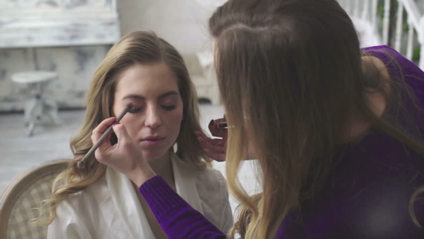 blonde girl in the roomhelps do make-up