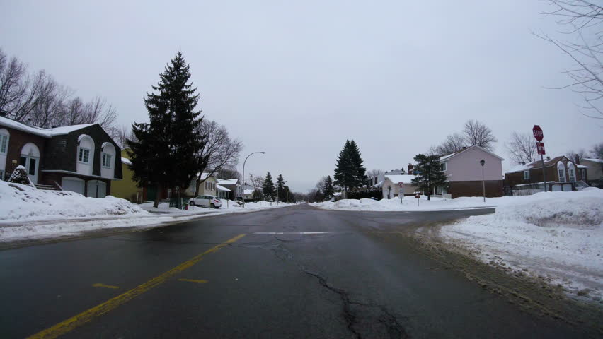 Low angle driving POV during cold winter in Montreal, Canada | Shutterstock HD Video #23899747