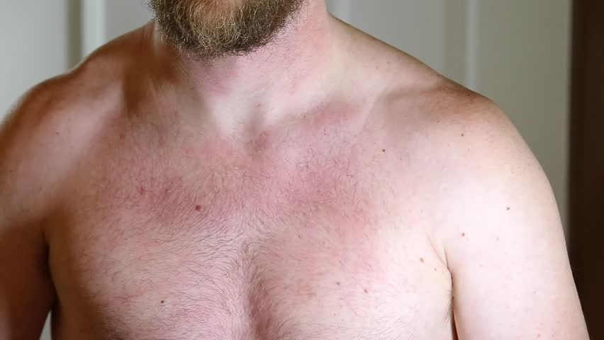 Man flexes his pectoral muscles in mirror | Shutterstock HD Video #23903575