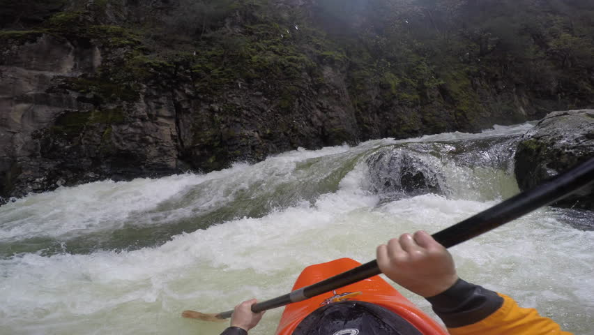 A first person video of a kayaker rolling and flying down a dangerous rapid | Shutterstock HD Video #23913898