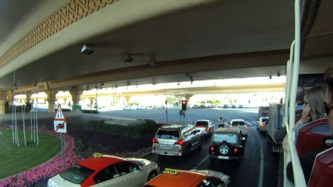 Dubai - Circa 2012: Bus tour through Dubai in 2012. Tourists on a bus tour through Dubai, United Arab Emirates.