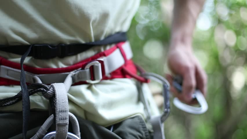 Slow motion detail at 120 fps of strong adult climbers hands clipping quickdraw to his harness getting ready to climb or belay. Extreme risk outdoor sport. Patagonia, Argentina. | Shutterstock HD Video #23930239