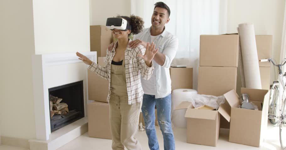 Happy young couple doing Virtual tour in new apartment #23943370