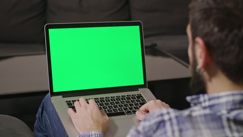 Close-up view of young man online shoping at home on pc, typing credit card number | Shutterstock HD Video #23961388