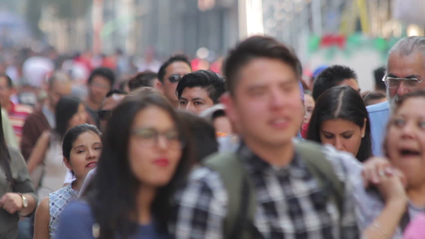 Mexico City, Mexico-CIRCA June,2017 TAKE 4: Crowd walking through street. In Mexico the populatIon growing is a public problem due the high birth rates.