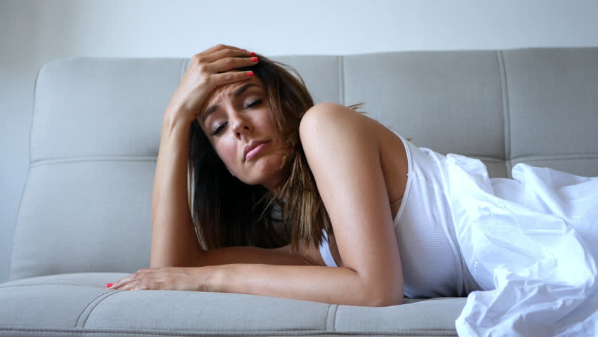 Woman with headache on the sofa      Shutterstock HD Video #23975401