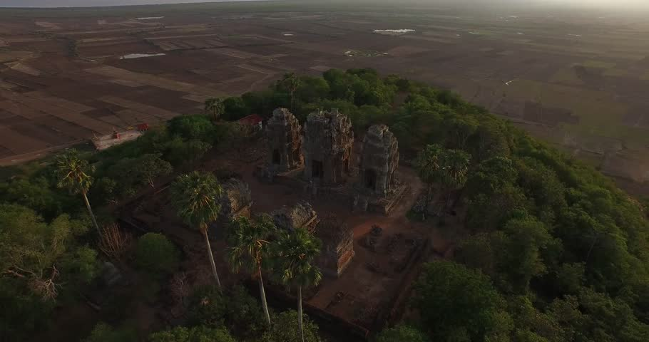 Aerial shot of Angkor Wat / Angkor Tom beautiful temple in Siem Reap during sunset. Camera is turning around Angkor Tom temple.