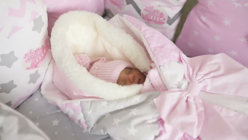 Sweet Baby Girl In Winter Overalls Sleeping In The Crib For A Transparent Canopy Bed The Newborn Is In The Crib