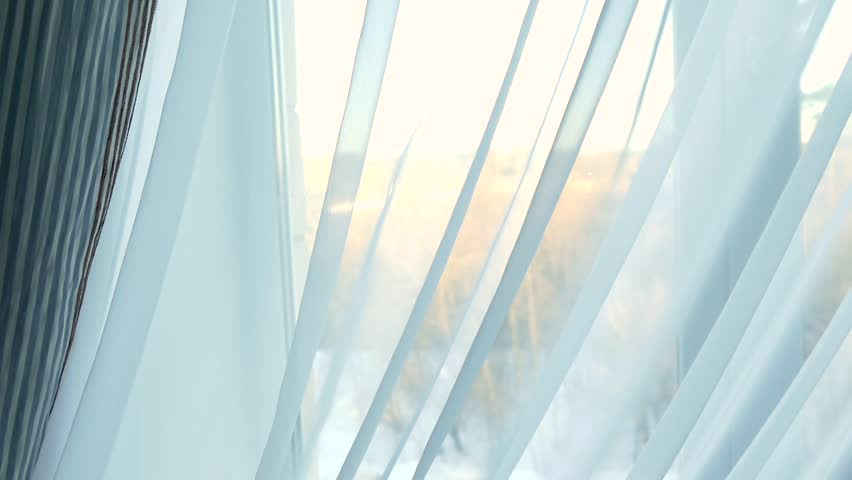 The sun behind the curtain in the window | Shutterstock HD Video #24019540