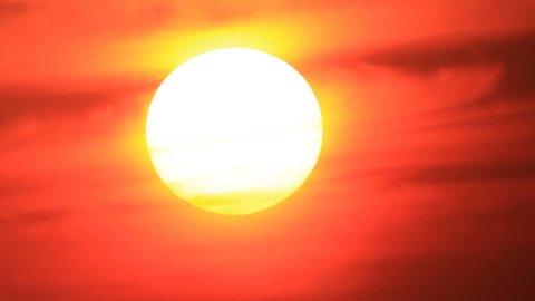 Aureole around sunset sun in misty atmosphere