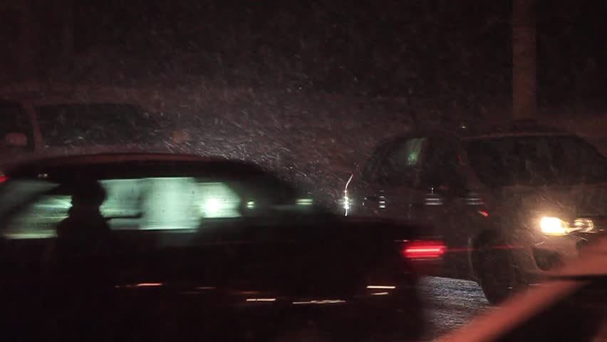 Blizzard, car traffic at night in city | Shutterstock HD Video #24026614