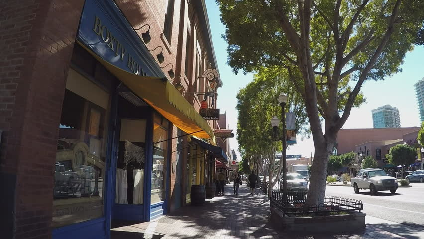 TEMPE, AZ/USA: January 31, 2017- Point of view walking on a sidewalk past shops and people in Tempe Arizona. Handheld camera view of one of the main roads in shopping district. | Shutterstock HD Video #24026872