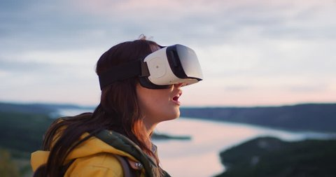 Young woman wearing virtual reality headset watching 360 video imagination VR concept
