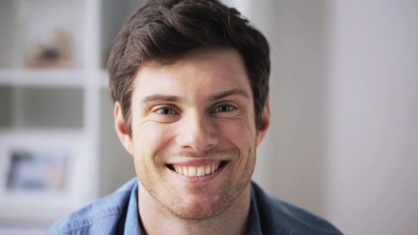 People, emotion, expression and portrait concept - happy smiling young man at home   Shutterstock HD Video #24030826