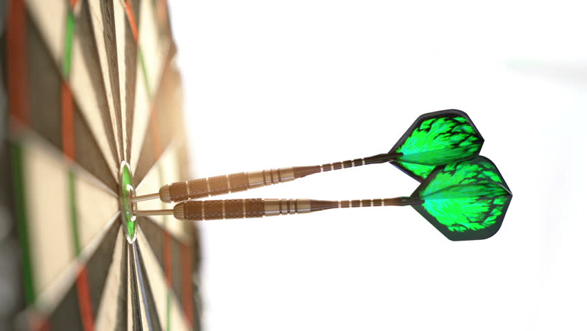 Close up of darts hitting the bulls eye on a dartboard