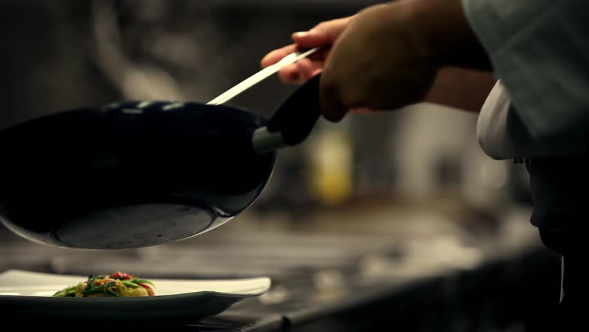Chef prepares a dish in a restaurant kitchen | Shutterstock HD Video #2404592