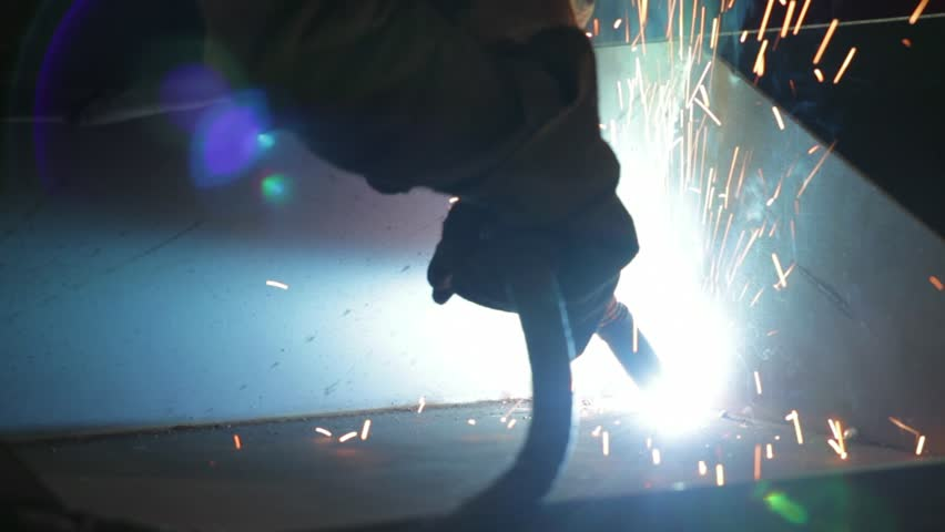 Workers grinding and welding in a factory. Welding on an industrial plant. | Shutterstock HD Video #24054139