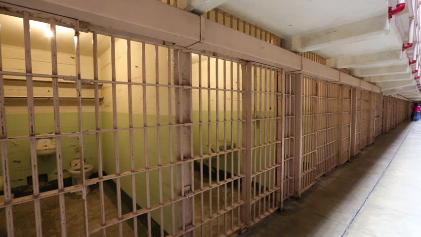 San Francisco, United States - August 14, 2016: Alcatraz prison steel barred doors of ordinary single cells, side by side on ground level in main corridor. San Francisco historical landmark.