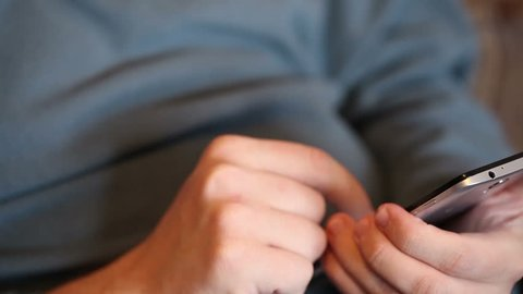 man uses the phone. Hands close-up