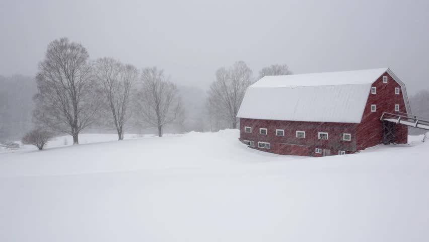 Winter snow on a big old red New England dairy barn in Etna,  New Hampshire.