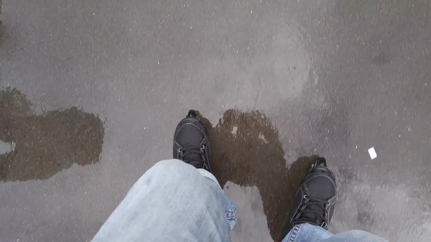 Black roller blades on legs of riding man, legs and reflections of pedestrians in wet asphalt, mobile phone video. | Shutterstock HD Video #24094378
