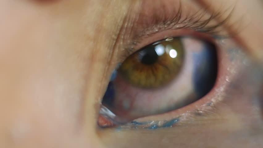 Tattoo artist does the tattoo on the eyeball   Shutterstock HD Video #24113521