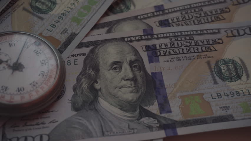 Time and Dollars. Close-Up   | Shutterstock HD Video #24125530