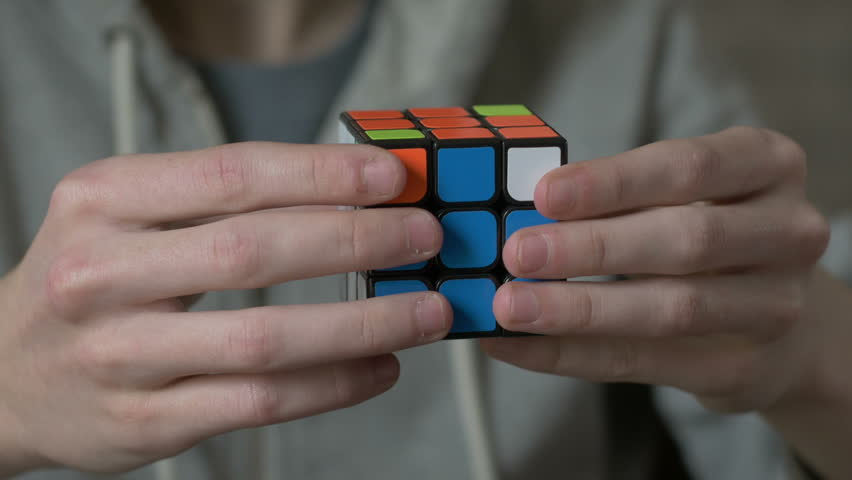 Boys hands solving rubik cube and showing thumb. Royalty-Free Stock Footage #24126658