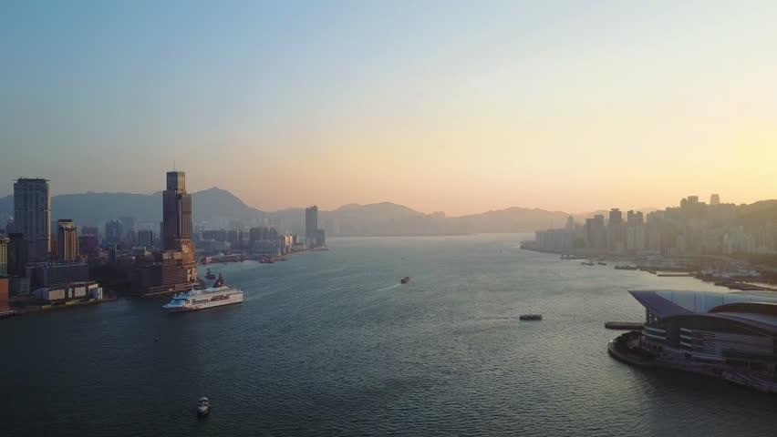 Aerial view of Hong Kong city at early morning time. Victoria bay and huge ship.