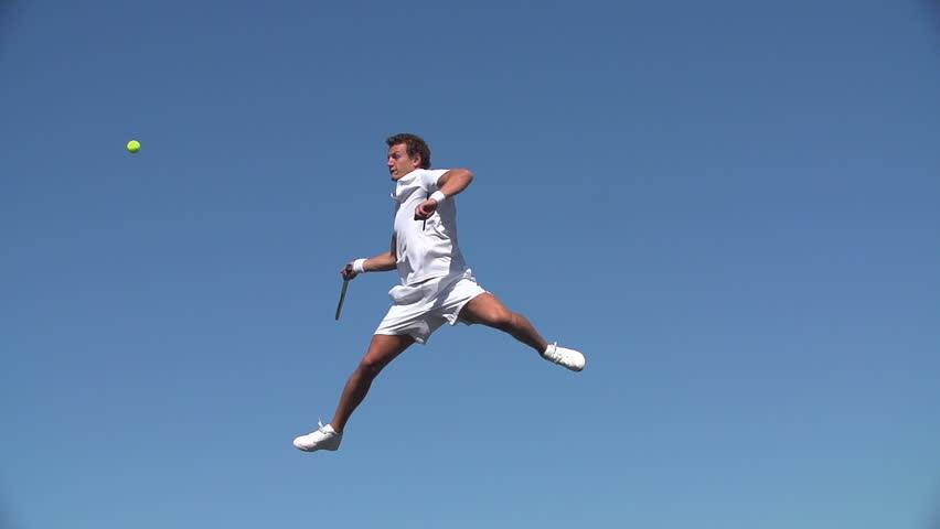 Tennis Player hits ball dressed in super white clothing. #24165820