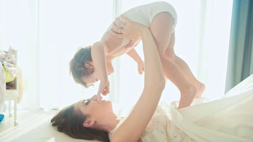 Young Mother and daughter having fun in bedroom , 4k slow motion clip | Shutterstock HD Video #24168385